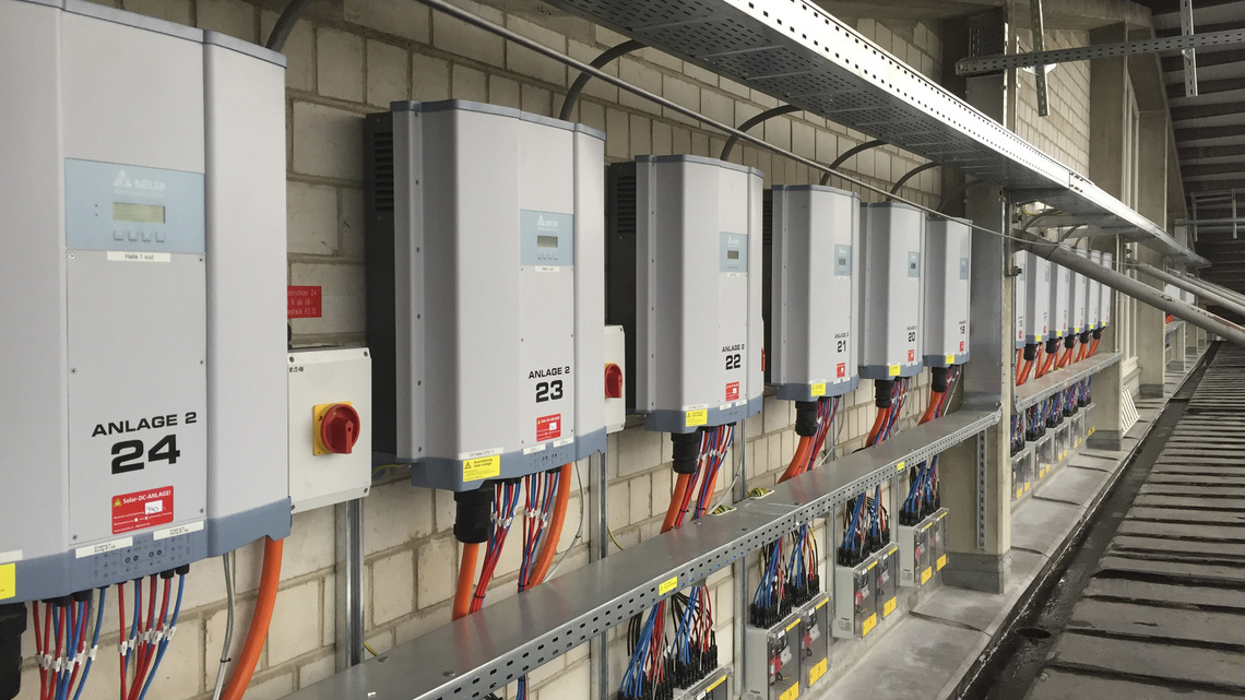 Delta RPI M50A inverters installed on the exterior of the warehouse