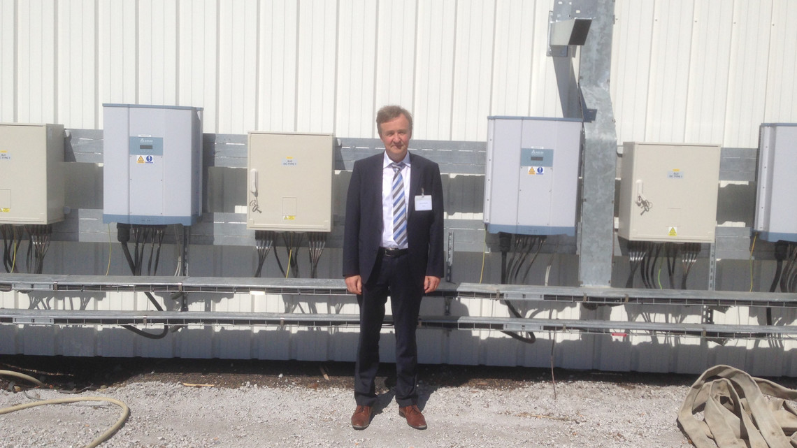 Pictured: Mr. Andreas Hoischen, Delta Solar Power Europe head, and Delta M50A inverters installed at the site