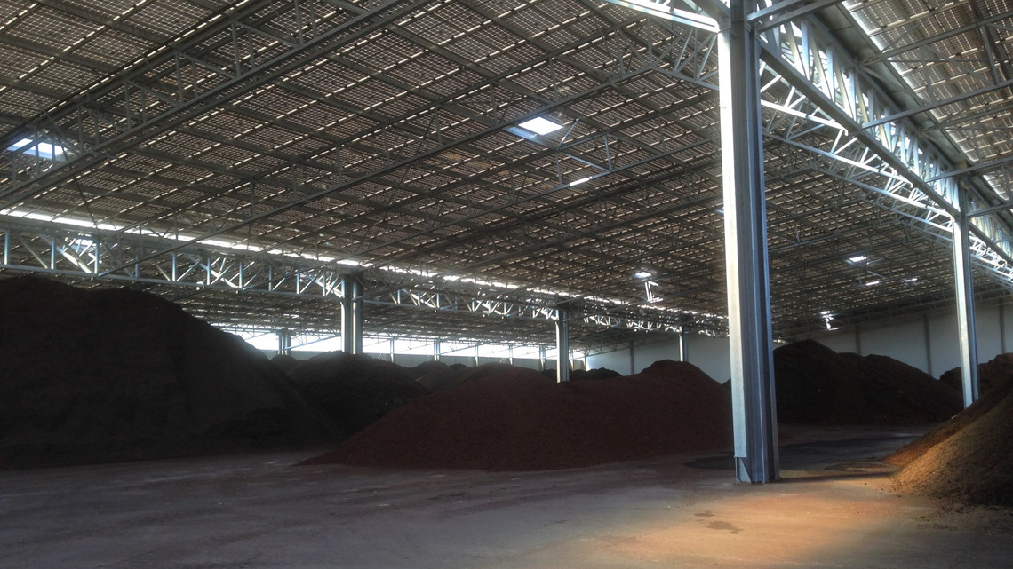 Peat shown under covered galvanized steel structure to protect it from the Mistral
